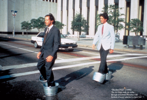 "Bucketfeet"" (1994) The Art Guys walk ten miles through downtown Houston with buckets of water attached to their feet"